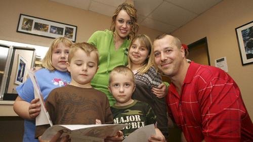 Which family got to meet Miley Cyrus (aka Hannah Montana)?