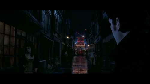 Why does Christian go back to the Moulin Rouge after Satine has told him that she's staying with the Duke?