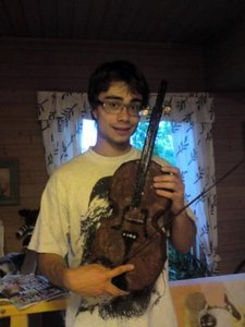 From what is made presented violin by Belarus fans to Alex?