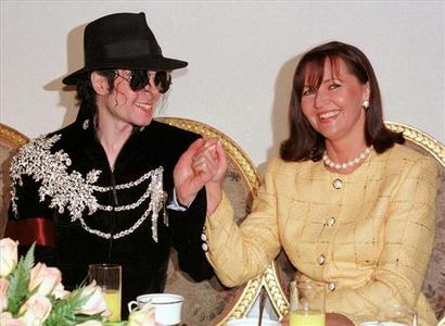 Who is in the Foto with Mike?*