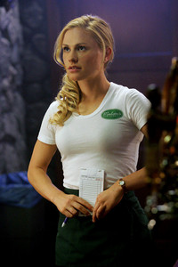 Who calls Merlotte's to speak to Sookie at work at the beginning of Strange Love?