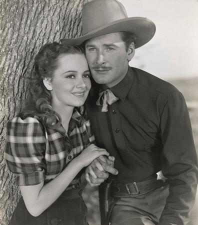 Errol Flynn co-starred with Olivia de Havilland in how many films ?