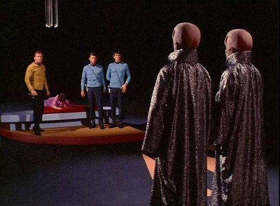 What two aliens kidnap Kirk, Spock and McCoy in the 'Empath'?