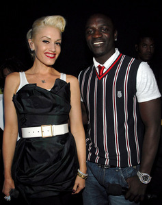akon is with _____ on this picture ?
