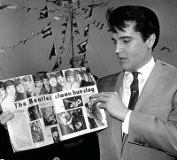 When The Beatles visited Elvis at his inicial in Bel Air on Friday August 27, 1965. They spent a total of 4 hours with the king. What did George do for most of the visit?