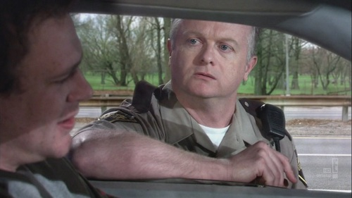 What was the name of the officer who almost gave marshall a ticket before he was offered bratwurst?