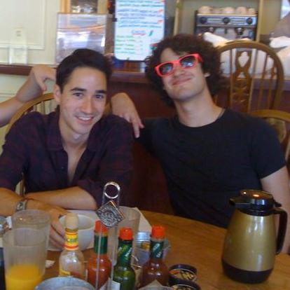 What are Darren's favorite songs by his brother's band?