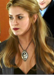 When Bella hears a gentle knocking on her door while she stays with the Cullens during Eclipse, who was it?