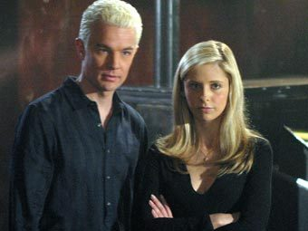 What clothing item does Spike steal of Buffy's when Riley catches him sniffing her sweater?
