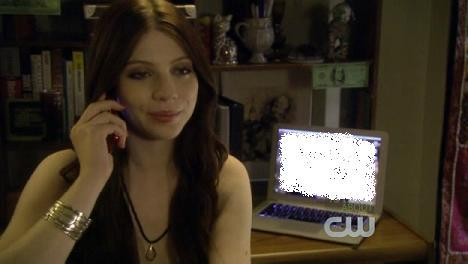 What does Georgina have as a desktop background on her laptop?