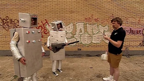 What did Jemaine say they wanted the robot costumes to look like?