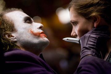 How does The Joker tell Rachel he got his scars?