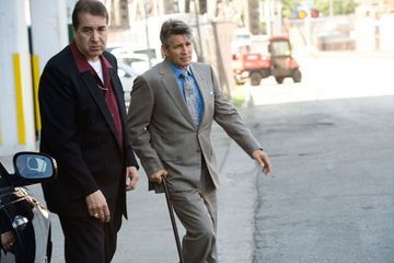Why is Salvatore Maroni walking with a cane?