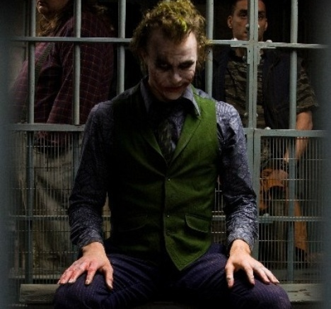 What did the Joker say he wanted while he held a kisu to his prison guard hostage?
