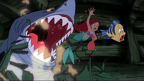 How do Ariel and Flounder escape the shark?