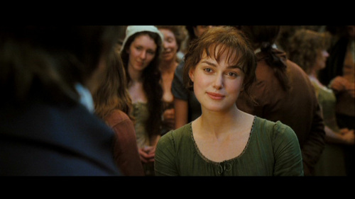"""In the book, how does Lizzie react to Mr. Darcy saying """"She is tolerable, but not handsome enough to tempt me""""?"""