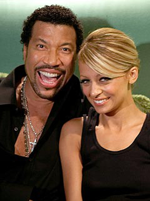 Nicole is Lionel Richie's biological daughter?