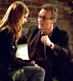 After Buffy realizes that Caleb has something that belongs to her, what does Giles suggest that it might be?