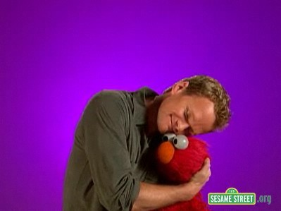 According to Elmo! Neil has how many dogs?