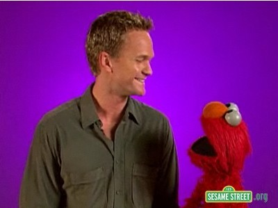 According to Elmo! What is a cool thing about Neil?