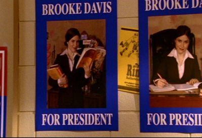 In 2x13 what kind of book is Brooke holding when Felix takes a picture of her for the presedential campaign posters?
