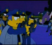 Whose house do the Springfield Cops break into when they're trying to catch a cattle rustler?