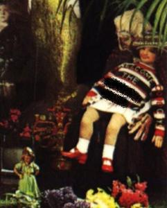 This doll from the cover of Sgt. Pepper is wearing a sweater paying homage to which group?