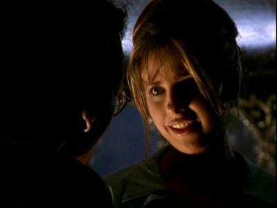 What is Buffy's first impression of Angel, as she expresses to Giles?