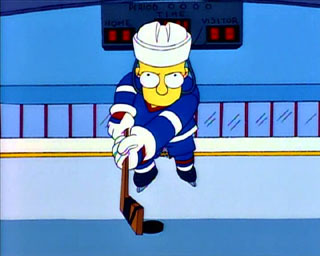 What is the name of the hockey team coached by Chief Wiggum?