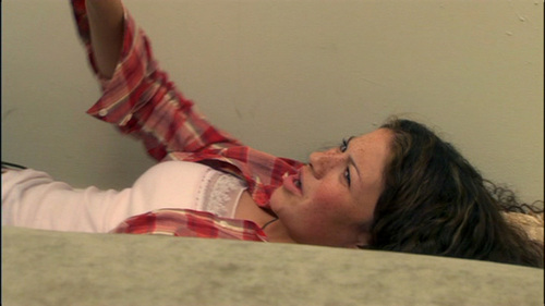 When Michael says that Maeby will end up like her mother, she says from behind the couch...