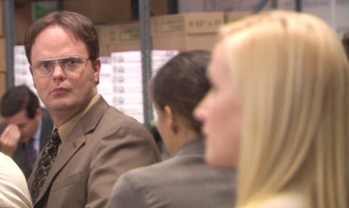 At what time does Dwight say that Angela must decide between him and Andy?