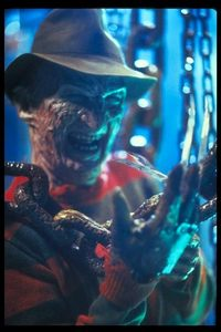 in a nightmare on elm street after Nancy pulls Freddy out of her dream in the basment he mutters somthing before she dunks gasoline on him what does he mutter?