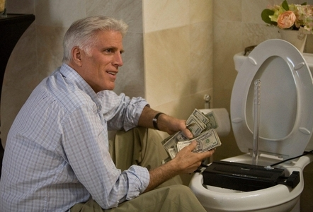In what movie does money literally go down the toilet?