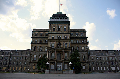 In the episode Abandoned NJ Psychiatrict Hospital. What did the digital recorder capture (twice) in the hallway at the beginning of the lockdown?