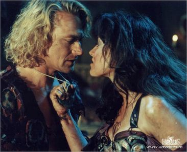 How does Xena get the attention of Iolaus?