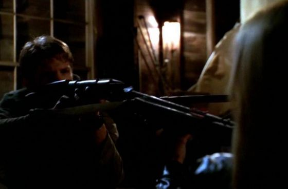 Riley with his electroshock gun and Buffy with her crossbow