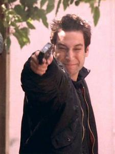 Warren, preparing to shoot Buffy