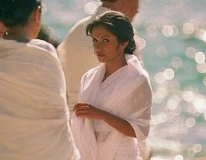 Mira Shenoy looking at Maya at Mohinder's funeral.