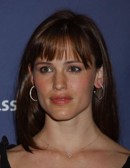 Jennifer Garner in mid-2006, wearing a pair of hoop earrings in her pierced ears