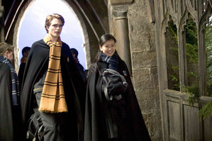 Cedric Diggory (Robert Pattinson) walking through Hogwarts with Cho Chang (Katie Leung)