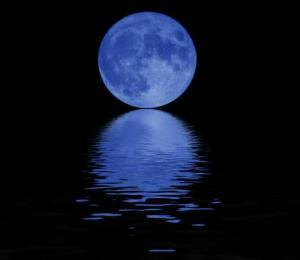 The moon was bright againest the pitt black sky.As the water glistened.