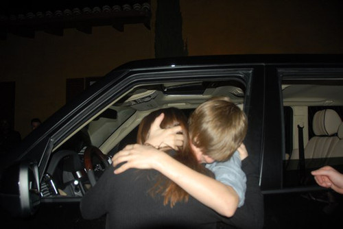 Justin at his Bday party hugging his sweet mommy cuz he got a car