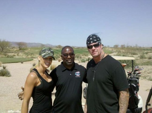 Michelle McCool and The Undertaker with a fan
