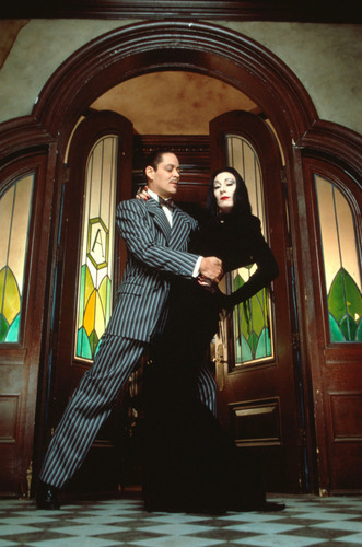 Raul Julia and Anjelica Huston