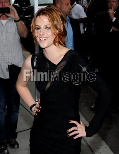 Kristen's hair is red and blonde