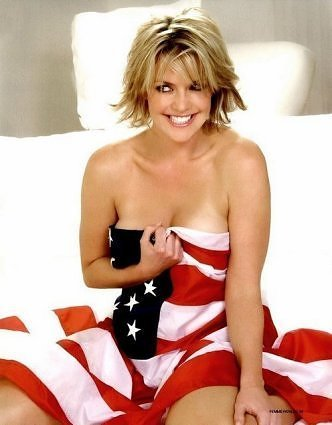 Amanda Tapping in a flag