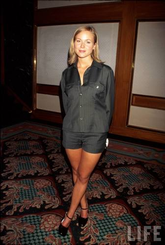 Singer Jewel in a Grey Dress Suit in 1996