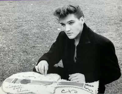 Elvis Presley- with a WELCOME BACK ELVIS cake