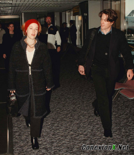 Gillian with Hugh Grant at Heathrow Airport, London February 13, 1999