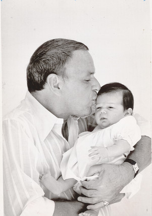 Frank with his First Grandchild